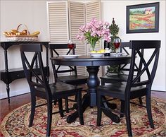 Black Kitchen Table i love this look! you could pair anything with it as well, table cloth cushions decorations.. love the round detailed chair look of this!