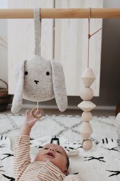 Wooden toys Perfect toy to be added to a play gym. Rabbit activity toy in grey and white stocked at Baby Play, Baby Toys, Kids Toys, Toddler Play, Bebe Love, Play Gym, Activity Toys, Toy Rooms, Plushies