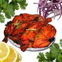 Hot succulent tandoori chicken. The spicy marinade and the fresh salad accompaniment.
