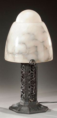 "EDGAR BRANDT Pair of Art Deco wrought iron lamps with alabaster shades, c. 1925, base signed ""E Brandt"", 37.5cm H."