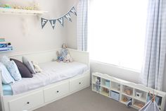 Boys bedroom - love the blue ikea spice rack for drink bottle and books