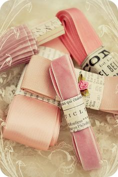 Storing vintage ribbons by banding them with strips of book pages. LOVE
