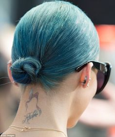 Changing it up: The 33-year-old's hair stylist Andy Lecompte changed her colour from blue ...