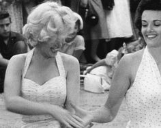 Marilyn Monroe and Jane Russell outside Grauman's Chinese Theater, June 23, 1953.