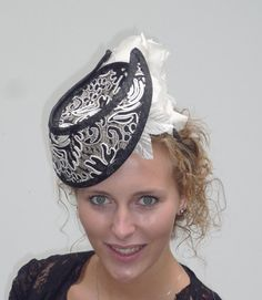 UNIQUE Dutch design modern couture headpiece black and cream / off white with flowers on alice band. $149.00, via Etsy.