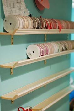 Ribbon-Storage from crown molding--I'd use it for my rubber stamp storage though! they couldn't fall of the shelf.