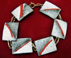 Vintage splatter enamel rectangular link bracelet Each link is white and navy blue with a red line Copper base links Artisan made 7 1/4 long almost 3/4 wide inches Unsigned Shows no wear Very good vintage condition International buyers welcome, I now offer 13$ flat rate jewelry shipping, overcharges are refunded Flat rate Priority shipping is optional Any questions, just ask. From a smoke from home. Thanks for looking.  Want to see more bracelets? Check out this link: https:/&#...
