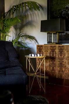 A custom-built burlwood credenza with a brass base (Photo: Laure Joliet for The New York Times)