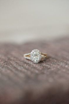 Oval-shaped #engagement ring idea - oval ring with halo setting and split-shank band {Amazing Celebrations & Events}