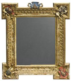 Property from the Estate of Arthur Neale Moore A Louis XVI style parcel paint decorated carved giltwood mirror 19th century The rectangular plate within beaded pokerwork borders, the projecting corners decorated with armorials.