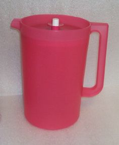 Tupperware New One Gallon Pitcher in Pink with Push Button Seal Tupperware,http://www.amazon.com/dp/B00AXA1JUM/ref=cm_sw_r_pi_dp_1ocPsb18N4BXW1A4