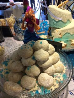 These are Italian Wedding Cookies with blue rock candy crumbled on top.
