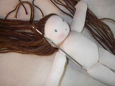 This was an amazing doll hair tutorial! When I make these Waldorf dolls, I'll be following this!                                                                                                                                                      More