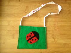 Image from http://mykidcraft.com/images/ladybird-ladybird-bag-ladybird-handbag-felt-ladybird-felt-bag-homemade-handbag-homemade-kids-bag-ladybird-felt-bag-kids-craft-bag1.jpg.