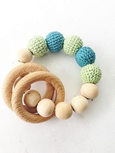 Love the crochet beads added to this wood teething ring! #baby #toys