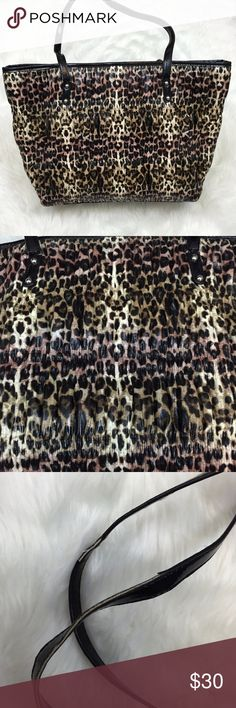 🍀NINE WEST Cheetah Print Medium Tote this has been used several times.  Wear on the handle as seen in the picture.  This is in good condition! Nine West Bags Totes