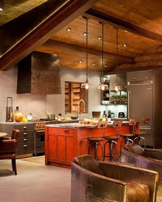 Rustic + Modern Kitchen....love the pop of color reddish/orange on the Island! Telluride Cabin by Trulinea Architects