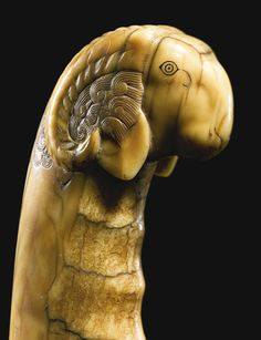 A Mughal carved marine ivory-hilted dagger with ram's head, 17th century