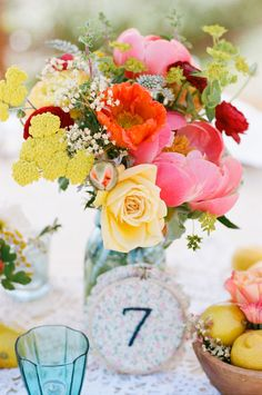 floral centerpiece with embroidered table number.