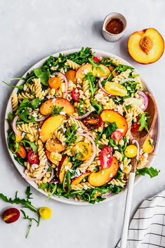 Delicious peach, tomato & corn arugula pasta salad made with juicy ripe peaches, cherry tomatoes, feta and sweet corn. This easy vegetarian pasta salad is tossed with just olive oil and fresh lemon juice for a light, but flavorful salad that's perfect for lunch, parties & picnics! #pasta #pastasalad #arugula #peaches #healthylunch #potluck #summerfood #sidedish #vegetarian Vegetarian Pasta Salad, Healthy Pasta Recipes, Healthy Pastas, Salad Recipes, Vegetarian Recipes, Lunch Recipes, Cooking Recipes, Easy Summer Meals, Summer Recipes