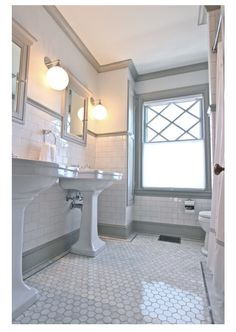 QUARTER design studio Victorian Bathroom Melrose, MA – marble hex floor with subway tile and grey trim moulding. Upstairs Bathrooms, Grey Bathrooms, White Bathroom, Beautiful Bathrooms, Bathroom Wall, Small Bathroom, Bathroom Ideas, Bathroom Layout, Bathroom Moulding