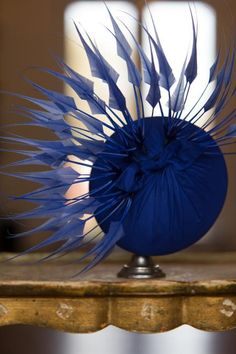 Cobalt blue silk pillbox with coque feather fan from On Your Head Be It