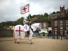 23 April 2014 Jouster Justine Pearson, of The Knights of the Damned Jousting team, and her horse Des commemorate St George's Day standing on...