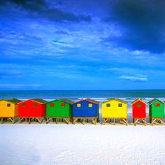 visit Cape Town, South Africa - see Muizenberg Beach + Table Mountain, do the famous Garden Route.