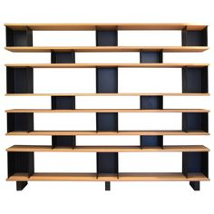 For Sale on - Large 'Horizontale' shelving unit in the style of Charlotte Perriand. Made of 8 solid clear-coated white oak shelves and 18 matte black powder coated steel Oak Shelving Unit, Brass Shelving, Antique Shelves, Oak Shelves, Wall Mounted Shelves, Diy Shelving, Storage Shelves, Unique Bookshelves, Modern Bookcase