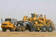 Cat haul truck with a Cat D10. On wagon