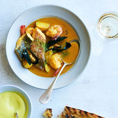 Learn to make star chef Daniel Boulud's refined version of the Provençal classic, bouillabaisse. Get the recipe at Food & Wine.