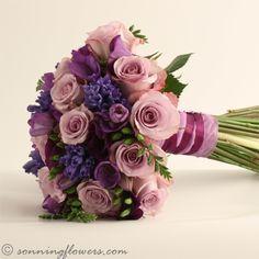 Memory Lane roses, blue hyacinth, purple lisianthus and purple freesia
