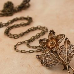 Old Floral Brooch Necklace -  This is a delicate one-off piece. An old filigree flower brooch pin recreated as a necklace pendant. Hung on antique brass chain (74cm). Let me know if you want to shorten it and I will do it free of charge.