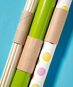 Slide empty toilet paper tubes over wrapping paper to keep it from unraveling.