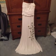 Gorgeous white dress Full length dress with floral detail on the skirt. 2 very small pulls that are not noticeable on. Worn once and dry cleaned. Dresses