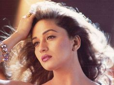 Madhuri Dixit might now be away from films and the entertainment industry, but she will always rule our hearts with her iconic performances and charming looks. On her birthday, here's looking back at the actor's younger days. Beautiful Bollywood Actress, Beautiful Indian Actress, Beautiful Actresses, Bollywood Stars, Bollywood Fashion, Bollywood Makeup, Bollywood Outfits, Bollywood Celebrities, Bollywood News