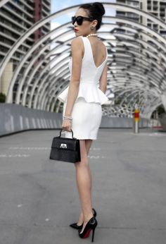 Peplum dress, makes a girl look gorgeous in any shape or form! love the small little black purse and big black shades. Also the V neck back! this reminds me of a Coco chanel inspired look!
