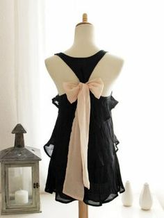 cute sheer black flowy racerback tani with pink bow.