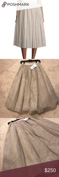 Elizabeth & James Sparkle Everleigh Midi Skirt NEW Brand new, never worn and never used! In excellent condition! Elizabeth and James nude/beige sparkle EVERLEIGH midi skirt. A-line tulle skirt that's been worn by celebrities, seen often on Ariana Grande! Skirt was worn on Scream Queens and red carpet premieres as well! Retails for about $500. Size 0! Elizabeth and James Skirts Midi