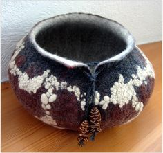 FELTING matters...     Love the design and colour of the vessel, and particularly the fastening/beads