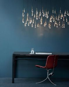 Seed Cloud Chandelier - rectangular 56 buds. Featuring solid cast bronze buds (polished), each housing tempered glass drop illuminated by LED. Also available in satin nickel finish.    OCHRE lighting design