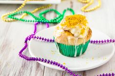 King Cake Cupcakes...Cupcakes inspired by the Mardi Gras favorite: sweet pastry dough filled with cream cheese and cinnamon.