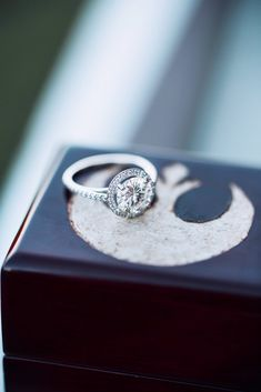 Beautiful halo engagement ring, and he even customized her ring box with a Star Wars Rebel Alliance symbol - So cute!