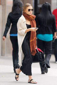 Ashley Olsen shows us an easy way to style a slip dress this season with aviator sunglasses, an oversized scarf, a breezy cardigan or an oversized button-down shirt, and sandals.