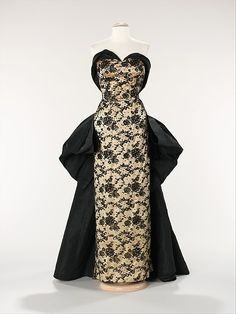 Design House: House of Balmain (French, founded 1945) Designer: Pierre Balmain (French, St. Jean de Maurienne 1914–1982 Paris) Date: 1953 Culture: French Medium: silk, rhinestones Dimensions: Length at CB: 54 in. (137.2 cm) Credit Line: Brooklyn Museum Costume Collection at The Metropolitan Museum of Art, Gift of the Brooklyn Museum, 2009; Gift of Mrs. Oscar Hammerstein II, 1956