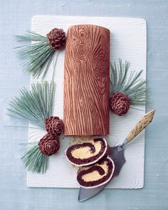 Yule Log... This Buche de Noel, the French Yule log cake, is richly detailed with a wood-grain pattern. It's made by pressing a plastic mat into rolled fondant and then rubbing the imprint with cocoa powder