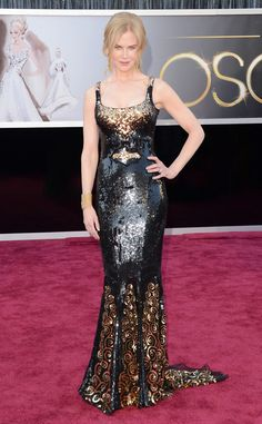 The statuesque star brought on the glitz in a beaded black and gold L'Wren Scott dress.