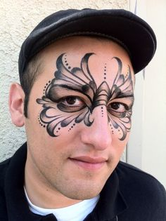 Cool looking face paint mask design by Face painter, Ronnie Mena Art, Studio City, LA,CA Black shades of butterfly Adult Face Painting, Mask Painting, Body Painting, Black Face Paint, Animal Face Paintings, Butterfly Face Paint, Face Paint Makeup, Face Painting Designs, Fairy Makeup