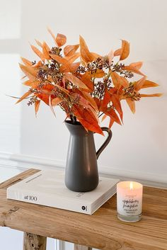 Get the look of fall, without the fuss. Try decorating with artificial fall leaves that look real! Simply trim the stems to varying heights to enjoy the colors of the season and no mess. Shop artificial fall leaves and ceramic vases at Afloral.com. Image by @housetohavendesign.