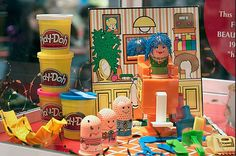 """Kids love PLAY-DOH and this was the set that started it all. In 1977, the PLAY-DOH FUZZY PUMPER BARBER & BEAUTY SHOP playset was introduced, featuring a play figure whose """"hair"""" can be extruded and then styled."""